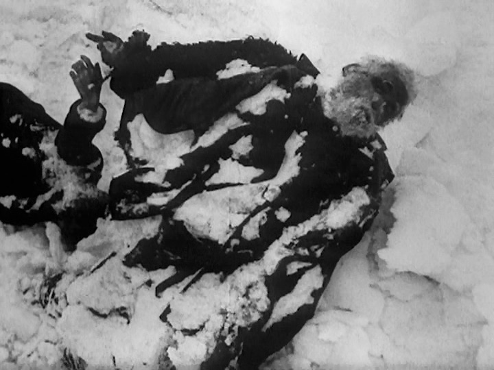 This event poster shows a film still depicting a dead body lying in the snow.