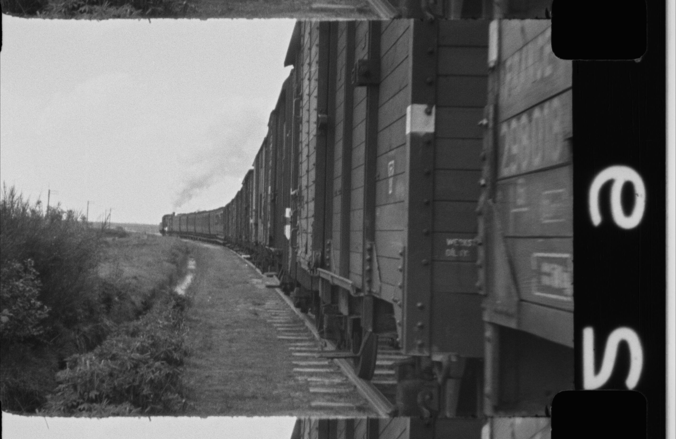 This black and white photo shows a train